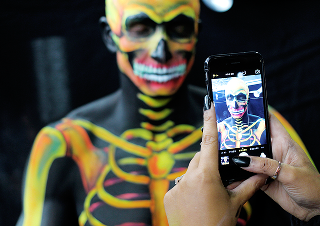 Head of Make-up Artistry Zoe Newlove writes about her experience at IMATS London 2015 Bodypainting Sean Lerwill as a Neon Skeleton with Anna Lingis